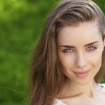 Portrait close up of young beautiful brunette woman
